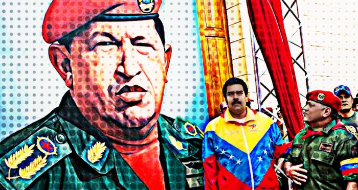 Maduro and a military officer salute a larger than life size portrait of Hugo Chavez