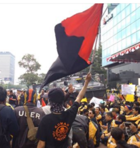 Kuman member with red and black flag