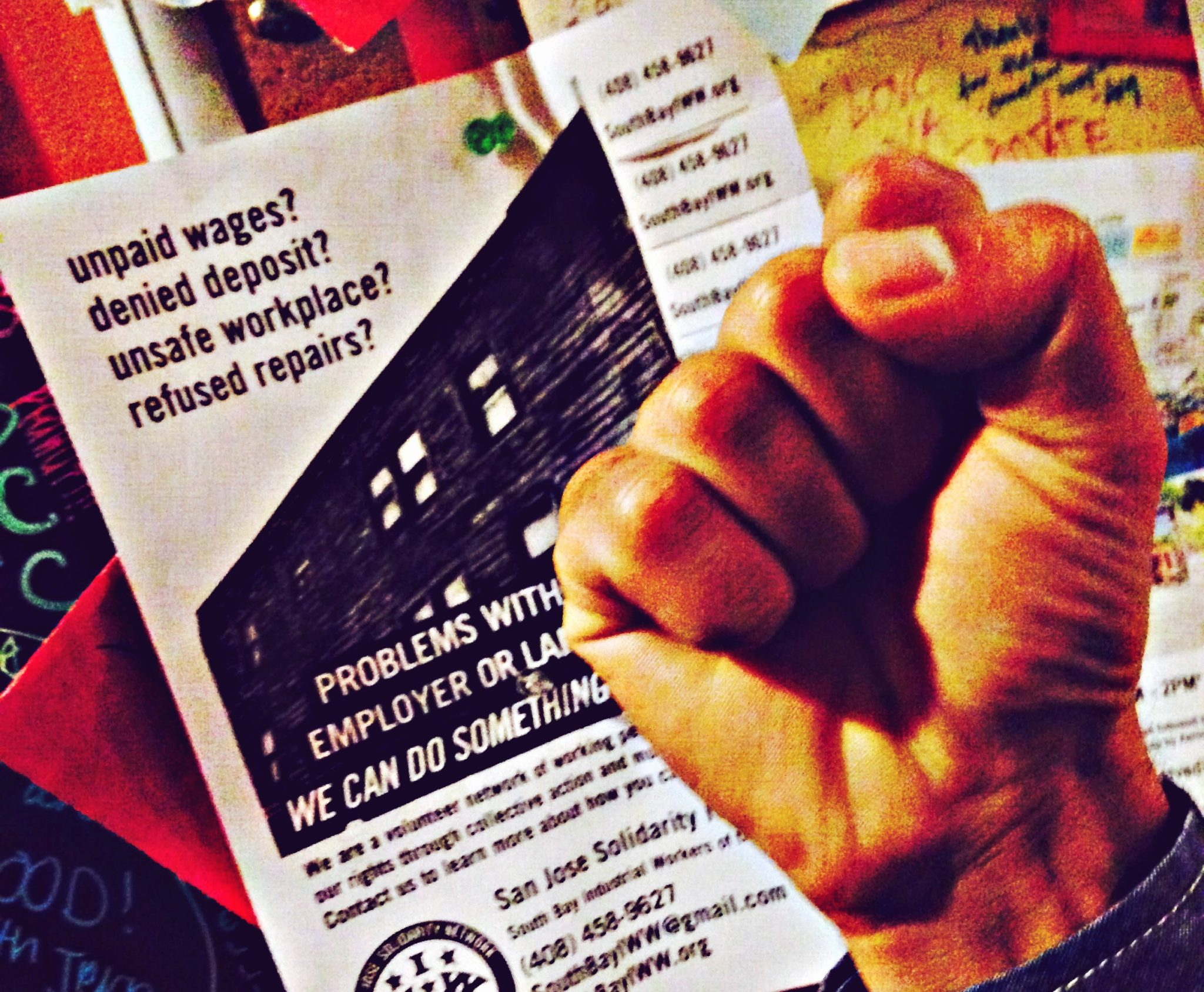 Solidarity network flyer with fist in front