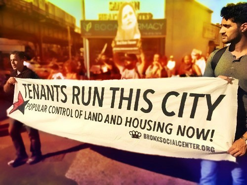 "Demonstrators holding banner saying ""Tenants Run This City"" in Bronx, NYC"