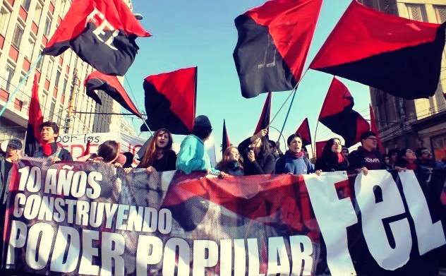 "Demonstration contingent of the Frente de Estudiantes Libertarios (FEL) with banner ""10 years building popular power"""
