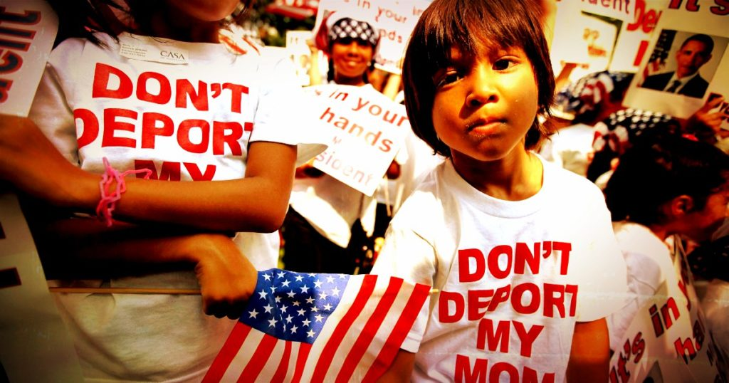 "Photo of rally with participants wearing shirts with ""don't deport my mom."""