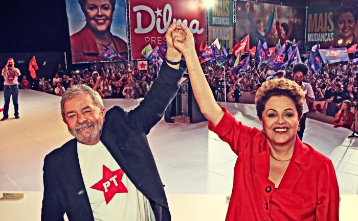 Former Workers Party (PT) Presidents of Brazil, Lula de Silva and Dilma Rousseff, on stage at a campaign rally.