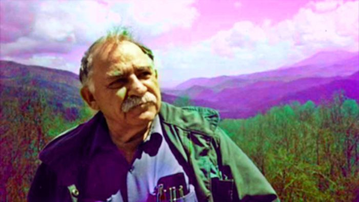 Colorized photo of Murray Bookchin, mountains in background.