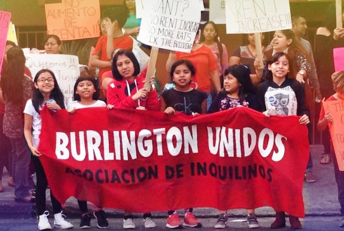 "Children's holding banner ""Burlington Unidos"" as part of a renter protest in Los Angeles."