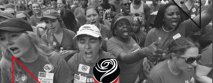 Black and white image of striking teachers marching.