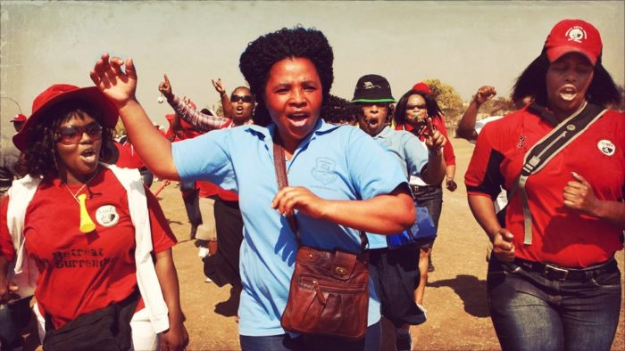 Members of South African Democratic Teachers Union take the streets during a strike.