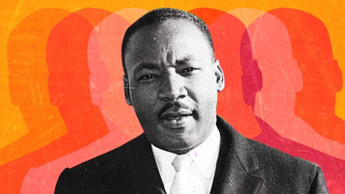 Black and white photo of MLK with outlined shadows in various colors to either side.